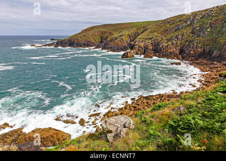 Porthzennor cove Wicca pool Tremedda Cliff and the South west Coast path Zennor head Cornwall England UK - Stock Photo
