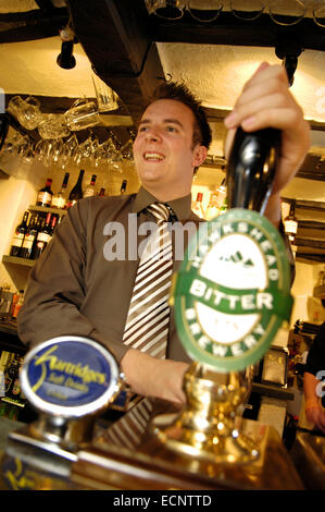 Pulling a pint in The Mason's Arms, Cumbria, UK - Stock Photo