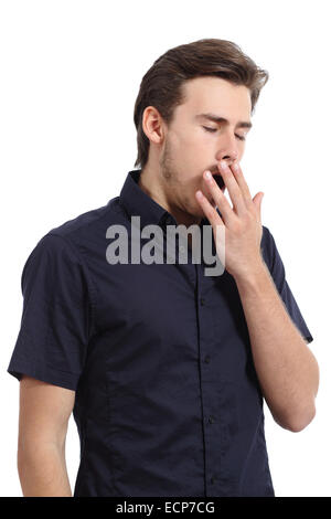 Tired man covering his mouth white yawning isolated on a white background - Stock Photo