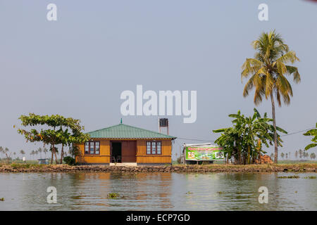Huts and small resort on the banks of river in Alleppey also known as Alappuzha in the state of Kerala, South of - Stock Photo