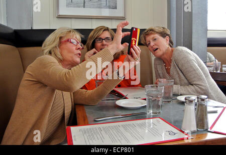 three friends take a selfie of themselves at restaurant cafe in Sonoma County - Stock Photo