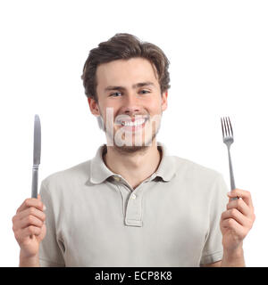 Young happy man holding a fork and a knife isolated on a white background - Stock Photo