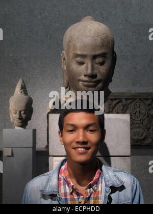 boy and Javayarman VII,Guimet museum,Paris,France - Stock Photo