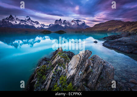 Sunset over Lago Pehoe and the Los Cuernos peaks in Torres del Paine National Park, Patagonia, Chile - Stock Photo