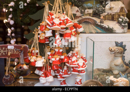 Father Christmas Tree decorations on sale at a market stall - Stock Photo