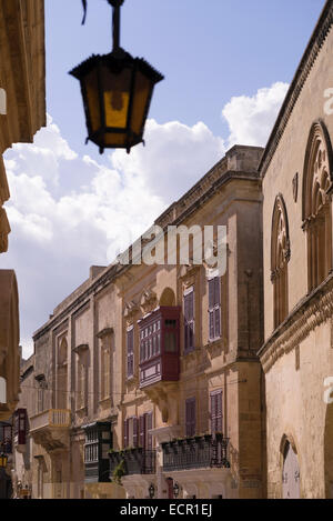 historic street with typical wooden balconies in Mdina Old Town - Stock Photo