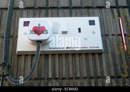 I love Xmas electrical plug artwork on Ganton Street near Carnaby Street in West London UK  KATHY DEWITT - Stock Photo