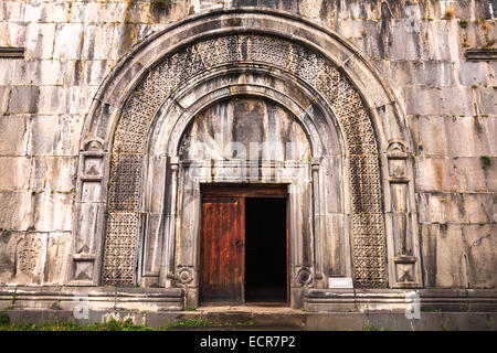 Arched doorway at the church of The Holy Sign of The Cross at Haghpat in Armenia - Stock Photo