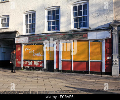 A closed and boarded-up shop in St Augustines Street, Norwich, Norfolk, England, United Kingdom. - Stock Photo