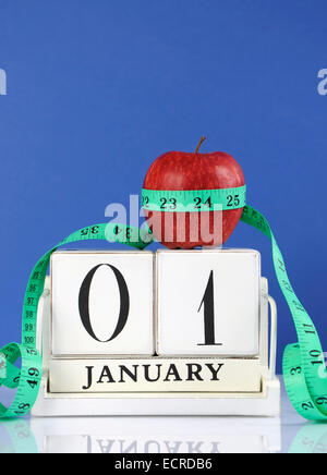 Happy New Year healthy slimming weight loss or good health resolution with red apple and measuring tape - Stock Photo