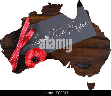 Australian Gallipoli Centenary, WWI, April 1915, tribute with Lest We Forget message and red poppy lapel pin badge - Stock Photo