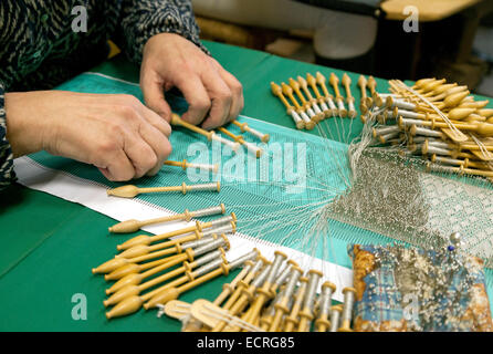 Close up of a woman doing bobbin lace making, a traditional craft, Bruges, Belgium, Europe - Stock Photo