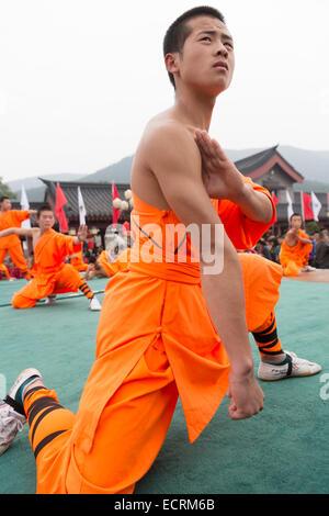 Shaolin Kung Fu student during performance at the opening ceremony of Zhengzhou International Wushu Fetival in DengFeng, - Stock Photo