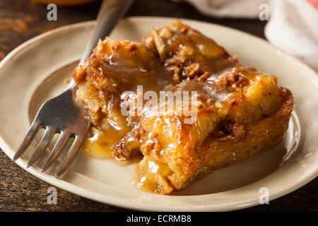 Sweet Homemade Bread Pudding Dessert with Brandy Sauce - Stock Photo