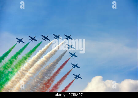 Frecce Tricolori making the Italian flag with smoke. - Stock Photo