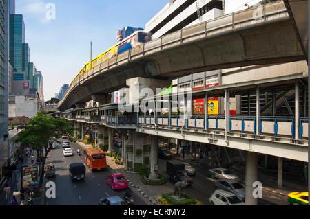 Horizontal cityscape of Bangkok's elevated BTS skytrain public transport network along Silom Road. - Stock Photo
