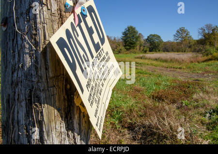 No Trespass sign on post in rural farm setting - Stock Photo