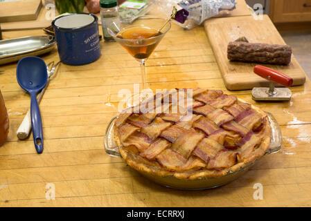 Bacon topped apple pie. - Stock Photo