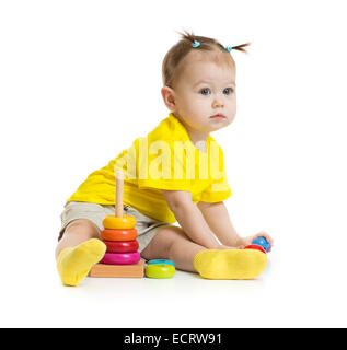 baby girl playing with colorful pyramid isolated on white - Stock Photo