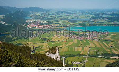 Germany  Bavaria  Swabia  East Allgaeu  Ammergau Alps  Tegelberg cable car and view to Fuessen - Stock Photo