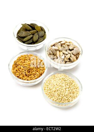 pumpkin seeds, sunflower seeds, linseed and sesame seeds - Stock Photo