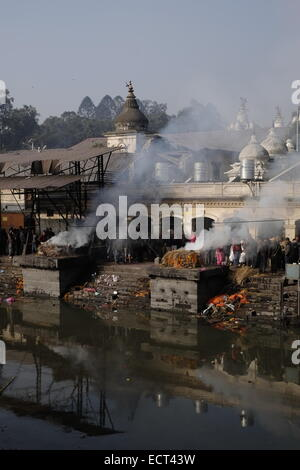 Cremation of dead people taking place at Pashupatinath Temple a Hindu shrine and one of the greatest Shiva sites - Stock Photo