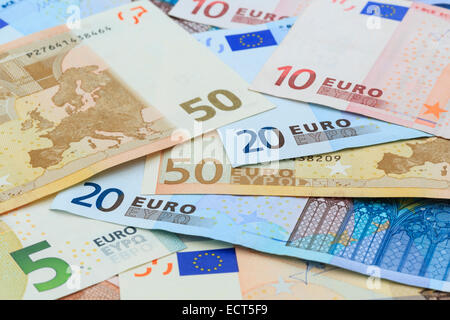 Euros in different denominations of Euro notes from the European Union Eurozone in close-up as a background. Europe - Stock Photo