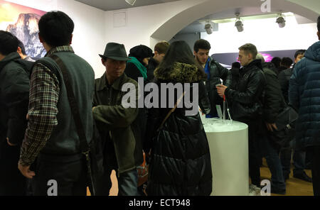 Moscow, Russia. 16th Dec, 2014. Shoppers check Apple products at an Apple store in Moscow, Russia, on Dec. 16, 2014. - Stock Photo