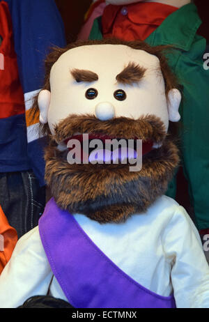 A grumpy old man hand puppet by SILLY PUPPETS for sale at a pre-Christmas market in Union Square Park in New York - Stock Photo