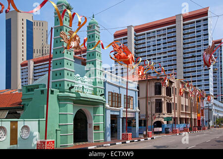 Masjid Jamae Mosque / Chulia Mosque with octagonal minarets at South Bridge Road in the Chinatown district of Singapore - Stock Photo