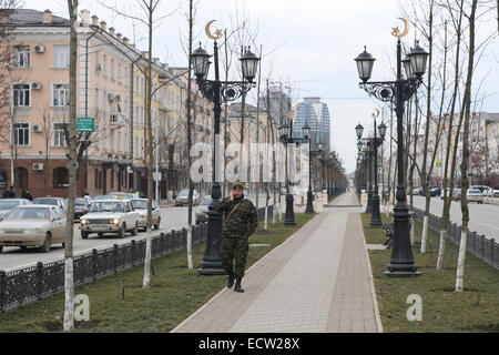 Soldier patrolling Putin Avenue, the former Victory Avenue, in the centre of the Chechen capital Grozny, Russia. - Stock Photo