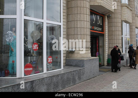 Shop window in Putin Avenue, the former Victory Avenue, in the centre of the Chechen capital Grozny, Russia. It - Stock Photo