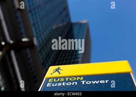 Euston Tower signpost with Euston Tower in the background, Euston Road, London, UK - Stock Photo