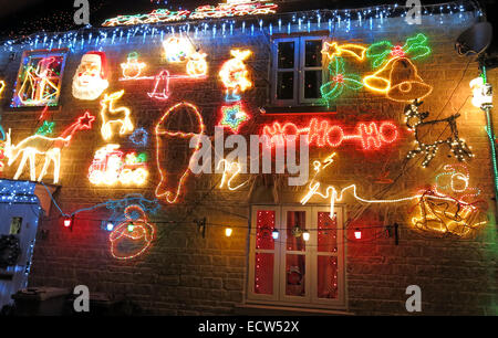 Christmas lights being overdone on a house - Stock Photo