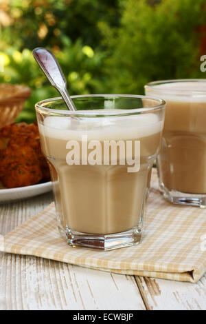 Chai or black tea made with milk and various spices - Stock Photo