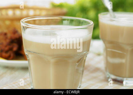 Indian Chai or black tea made with milk and various spices - Stock Photo
