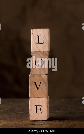 Stamping blocks with the word LOVE spelled out  stacked - Stock Photo