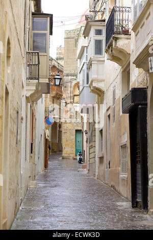 Street with traditional maltese balconies stock photo for Traditional balconies