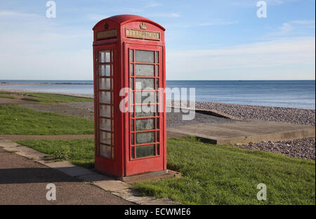 telephone box on the beach at budleigh salterton devon - Stock Photo
