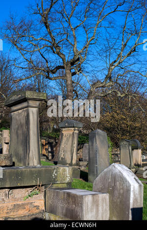 View of neglected graves on a sunny Winter's morning in New Calton Burial Ground in Edinburgh, Scotland, UK. - Stock Photo
