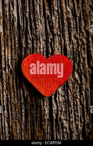 Wood red heart set on rustic wood with selective focus - Stock Photo