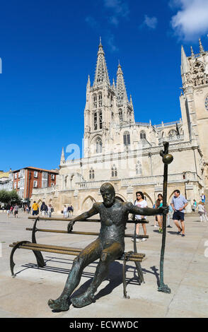 BURGOS, SPAIN - AUGUST 13, 2014: Statue of Pilgrim on the Camino de Santiago in front of the gothic cathedral in - Stock Photo