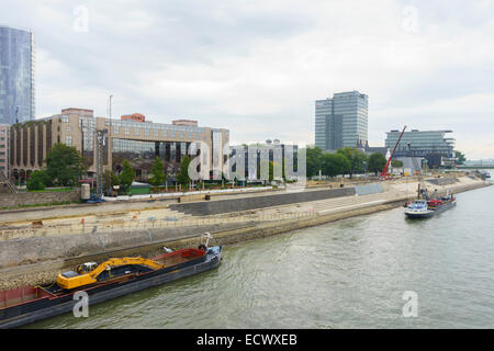 Construction work strengthening the banks of the Rhine river in Cologne, Germany - Stock Photo