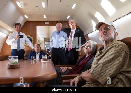 USAID contractor Alan Gross, imprisoned in Cuba for five years, watches television news of his release along with - Stock Photo