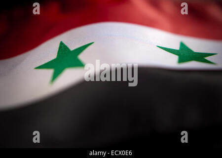 Abstract macro view of Syrian flag with shallow depth of field. - Stock Photo