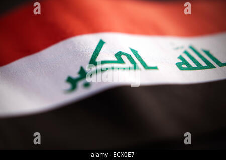 Abstract macro view of Iraq flag with shallow depth of field. - Stock Photo