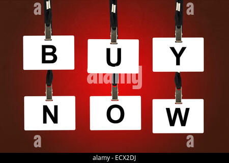 buy now word on badge with red background - Stock Photo