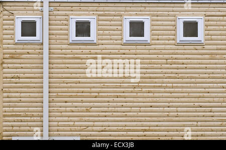 New wooden building with pvc windows - Stock Photo