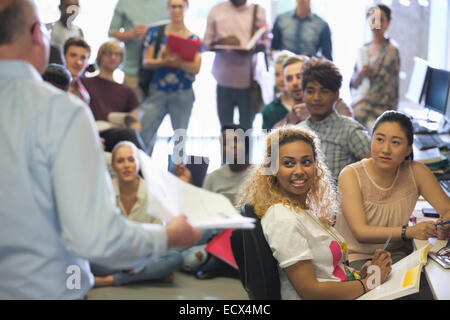 Group of students listening to teacher during lecture - Stock Photo