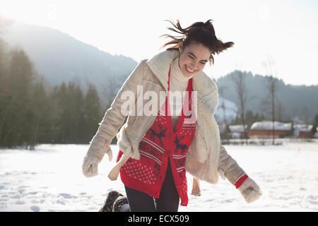 Happy woman in snow - Stock Photo